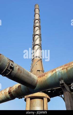 Somkestack of an old abandoned industrial complex - Stock Photo