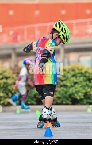 BEIJING-JULY 10, 2015. Boy practicing inline skating. Although Ping-Pong, basketball, badminton are China's top - Stock Photo