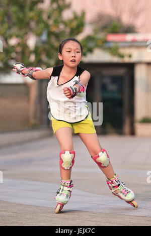BEIJING-JULY 10, 2015. Girl practicing inline skating. Although Ping-Pong, basketball, badminton are China's top - Stock Photo