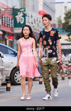 BEIJING-JULY 10, 2015. Young lovers on the street. According 2010 national census, China's unmarried population - Stock Photo