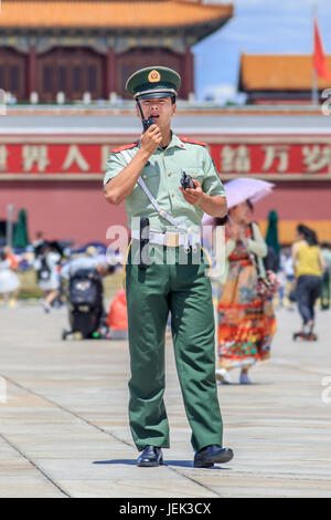 Honor guard on Tiananmen Square. Honor guards are provided by the People's Liberation Army at Tiananmen Square presence. - Stock Photo
