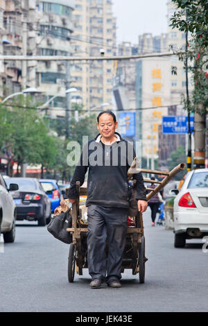 WENZHOU-NOV. 19, 2014. Trash collector on the street. In China recycling is done by trash collectors who specialize - Stock Photo
