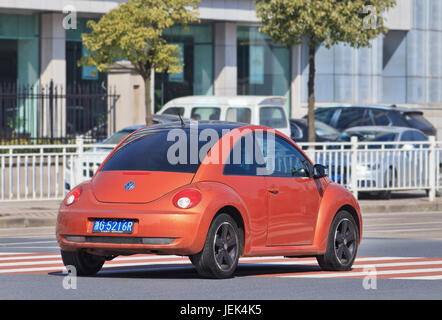 Orange Volkswagen Beetle. China is the place where VW CEO Matthias Mueller can enjoy brief respite from its worldwide - Stock Photo