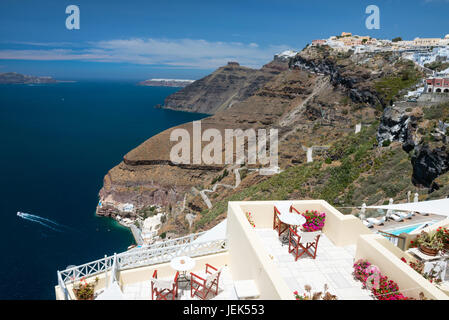 White cupola of church with Aegean sea and volcanic island in background, Santorini, Greece - Stock Photo