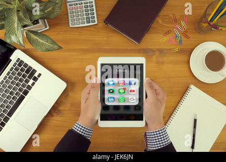 BANGKOK, THAILAND - JUNE 9th, 2017 :  man using Iphone social media on screen life style to  Share Social Media - Stock Photo