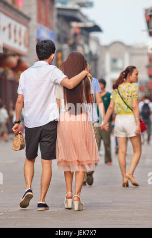 BEIJING-JUNE 9, 2015. Young couple in love in city center. Recent study showed divorce rate among middle-aged Chinese - Stock Photo