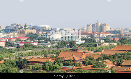 BEIJING-JULY 26, 2016. High angle view on Palace Museum pavilions with CBD on background. It was the imperial palace - Stock Photo