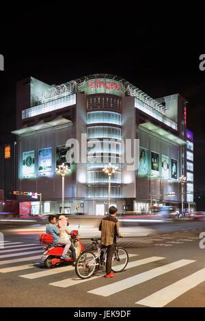 KUNMING-JULY 3, 2014. Gingko shopping center at night. The high-end Kunming Gingko Shopping Center is home to exclusive - Stock Photo