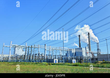 ROTTERDAM-AUG. 10, 2012. E.ON power plant  on Aug. 10, 2012 in Rotterdam. Its two coal-fired units of 550 MW operate - Stock Photo