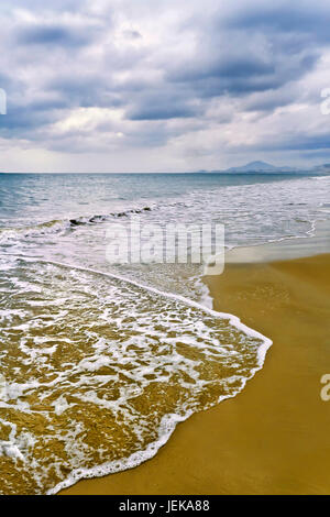 Threatening dark clouds on top of a abandoned beach in Sanya, South of China - Stock Photo