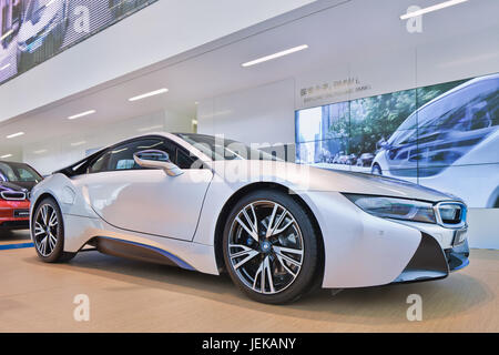 New BMW i8 sports-car. The i8 is an intelligent lightweight constructed plug-in hybrid sports-car with an acceleration - Stock Photo