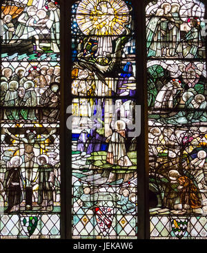 Stained glass by Christopher Whall south window of Transept St. John the Baptist Church Burford Oxfordshire England - Stock Photo