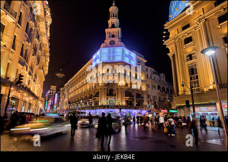 Nanjing East Road at night time. Nanjing Road is the main shopping street of Shanghai, China, and is one of the - Stock Photo