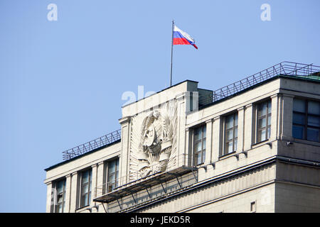 Russian flag on top of the State Duma of Russian Federation Building, Moscow - Stock Photo