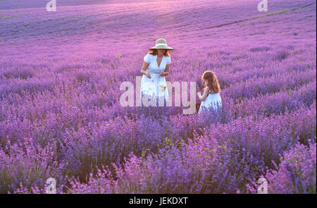 Mother and daughter standing in a lavender field, Bulgaria - Stock Photo