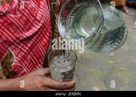 BANGLADESH, District Tangail, Kalihati, village Southpara, drinking water / Trinkwasser im Glas - Stock Photo