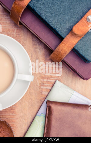 Close-up of coffee with wallet and diaries - Stock Photo
