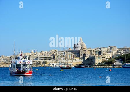 View of St Pauls Anglican Cathedral and the Basilica of Our Lady of Mount Carmel seen from the Grand Harbour, Valletta, - Stock Photo