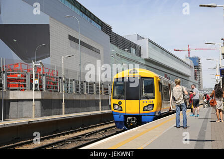 A London Overground train arrives at the newly constructed Shepherds Bush station, next to the Westfield Shopping - Stock Photo