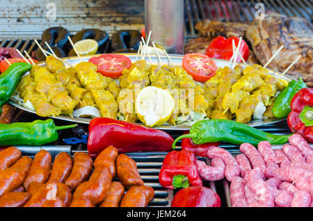 raw spiced chicken meat skewers,  Toulouse sausages, raw sausages, Blood sausages and Raw Pork ribs. Raw met for - Stock Photo