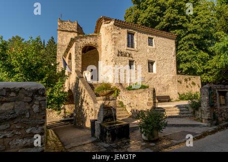 City hall of the medieval village of Saint-Guilhem-le-Désert, one of les plus beaux villages de France. Hérault. - Stock Photo