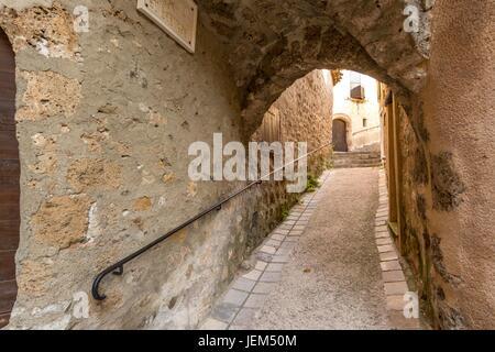 A  street in the medieval village of Saint-Guilhem-le-Désert, one of les plus beaux villages de France. Hérault. - Stock Photo