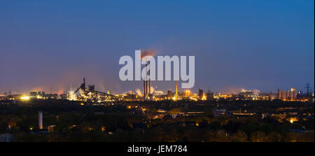 Panoramic view of a large coking and steel plant in Duisburg, Germany in the night with tapping resulting in the - Stock Photo
