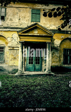 Abandoned mental hospital in the forest - Stock Photo