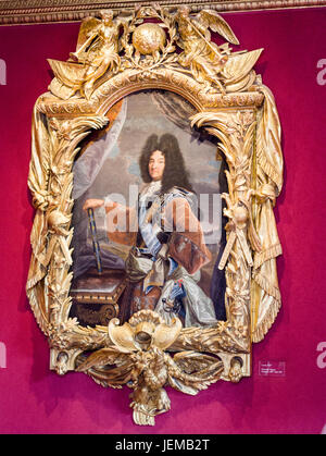 Portrait of Louis XIV by Hyacinthe Rigaud: Set in a heavy and ornate gilt frame it shows the sun king posing with - Stock Photo