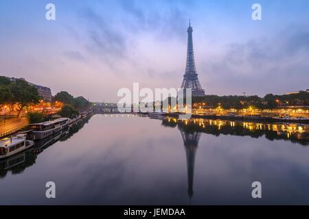 Paris city skyline with Eiffel Tower and Seine River when sunrise, Paris, France - Stock Photo