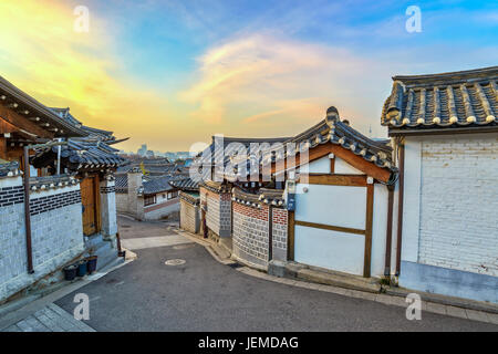 Bukchon Hanok Village and Seoul city skyline when sunrise with Seoul Tower, Seoul, South Korea - Stock Photo
