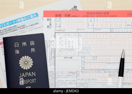Application for Japanese passport with a pen - Stock Photo