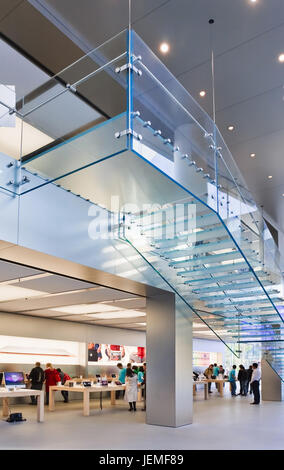 Apple flagship store interior in Beijing. Apple is one of the successful brands in China which speaks to the imagination - Stock Photo