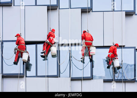 BEIJING - APRIL 28, 2009. Window cleaners at work. They are known as spider-men because they entrust their lives - Stock Photo