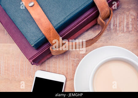 Coffee with smartphone and diaries - Stock Photo