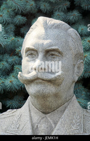 Statue of Soviet military commander Semyon Budyonny,  in front of the Kremlin wall at Red Square in Moscow, Russia - Stock Photo