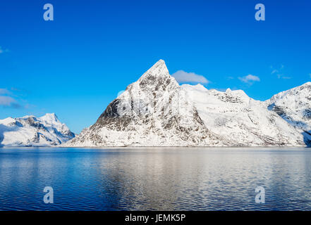 Mount Olstind reflected in the calm waters of Reinefjord on the Lofoten Islands