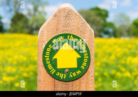 The Limestone way sign on a post outside Tissington Village derbyshire peak district Derbyshire England East midlands - Stock Photo