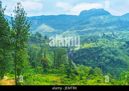 The highlands of Sri Lankan Central province, covered by forests and tea estates, hide the scenic waterfalls - Ramboda - Stock Photo