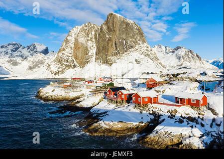 Wooden houses on rocky coast - Stock Photo