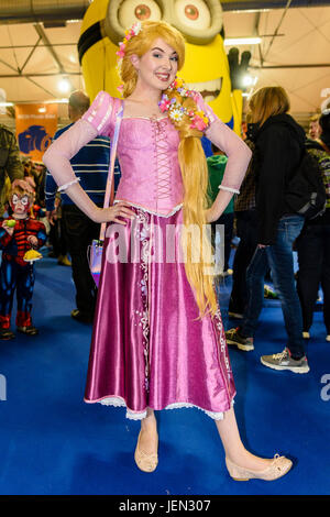 Lisburn, Northern Ireland.  25/06/2017 - A pretty young lady dressed up as the Disney version of the character Rapunzel - Stock Photo