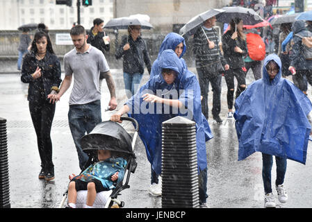 Parliament, London, UK. 27th June, 2017. A heavy downpour of rain near Parliament. Credit: Matthew Chattle/Alamy - Stock Photo
