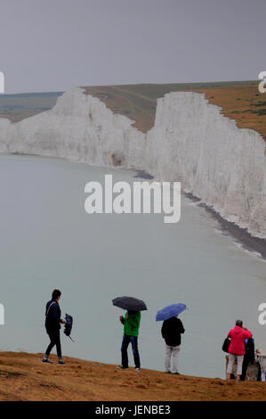 Birling Gap, Eastbourne, East Sussex, UK. 27th June, 2017. Umbrellas order of the day at the Sussex beauty spot. - Stock Photo