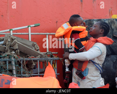 Charity from Ghana and her one-and-a-half year old son pictured aboard a civilian ship in the Mediterranean, 27 - Stock Photo