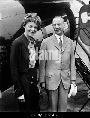 Amelia Earhart (L), Portrait with Man in front of Airplane, Harris & Ewing, 1932 - Stock Photo