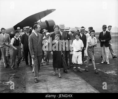 Amelia Earhart with Group of People near Airplane, Harris & Ewing, 1932 - Stock Photo