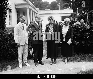 U.S. President Herbert Hoover Presenting National Geographic Society Medal to Amelia Earhart, White House, Washington - Stock Photo
