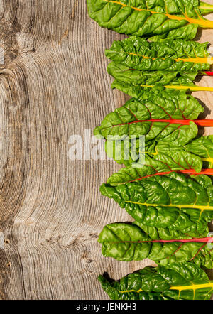 Flat lay rainbow swiss chard healthy diet recipes mock up wood background with copy space - Stock Photo