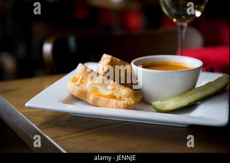 Grilled cheese sandwich with tomato soup served at a casual restaurant - Stock Photo