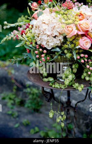 Wedding Centerpiece With White And Pink Flowers In Rustic Garden